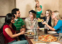 Group people eating a tasty pizza